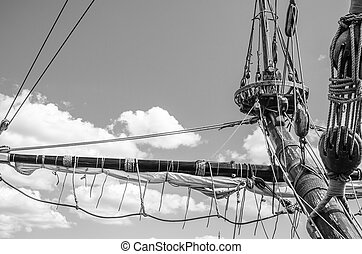 Mast with sails of an old sailing vessel, black and white...