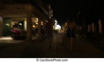 Hyperlapse of family walking in night street - Hyperlapse...