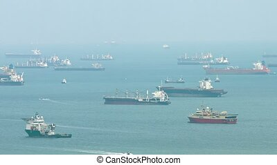 Many Commercial Cargo Ships at Anchor - Many, enormous,...
