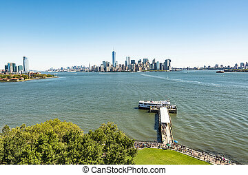 scenic view from Ellis Island to downtown New York. The...