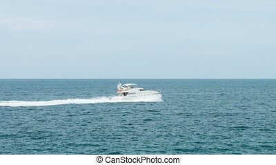 Luxury Motor Yacht Cruising on a Tropical Sea FullHD video -...