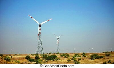 Single Turbine Rotating on a Wind Farm in India - Triple...