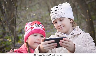 Girls watching photos in your phone - Girls leaf pictures in...