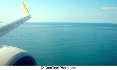 Airplane's Wing and Engine Crossing Beach and Landing. Video...