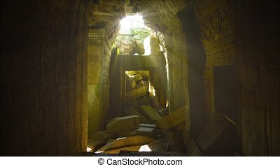 Dim Sunlight Filters through Hole in Roof of Ancient Temple...