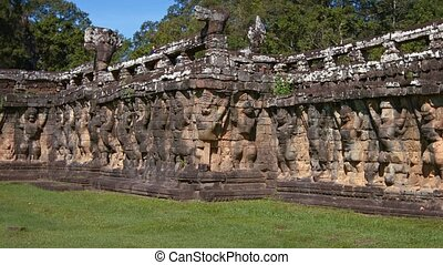 Ancient Stone Sculptures at Terrace of Elephants at Angkor...