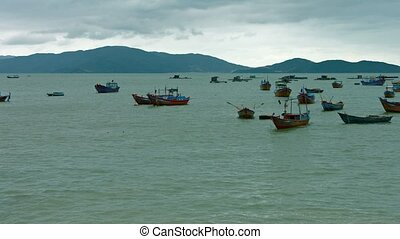 Small Boats Anchored off Nha Trang, Vietnam - Many small,...