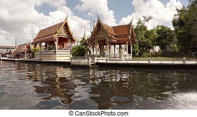 Cruising Past a Buddhist Temple Complex in Bangkok - Low...