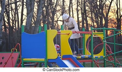 Children kataetyusya with slides at the playground -...