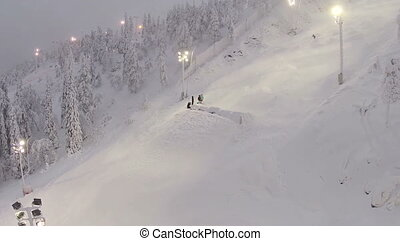 Skier Riding On Hill At Night - Aerial view of a skier on a...