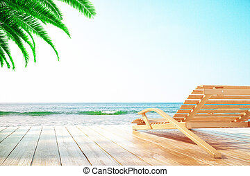 Chaise longue and palm tree