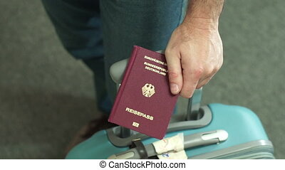German Travel Passport Luggage Male - Anonymous male holding...