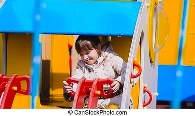 Girl in the park behind the wheel of a car - Girl in the...
