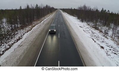 Driving Along A Winter Road - Aerial view of the winter...
