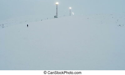 Skier Coming Down The Slope - Aerial view of a lonely skier...