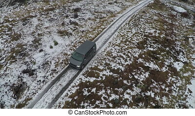 Car In The Frozen Snowy Countryside - Aerial shot of a car...