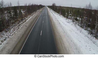 Flying over empty road in the north - Aerial shot of empty...