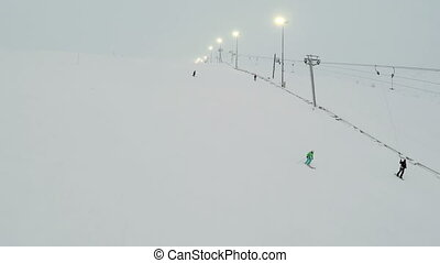Chair Lifts And Skiers On Slope - Aerial view of a skiers on...
