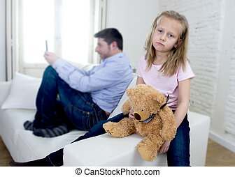 internet addict father using mobile phone ignoring little sad daughter bored hugging teddy bear