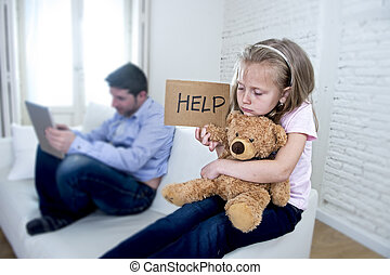 internet addict father using digital tablet pad ignoring little sad daughter bored hugging teddy bear