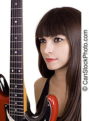 Brunette and red guitar - Latino woman with brown hair...
