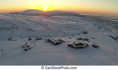 Flying over the ski centre area at sunset