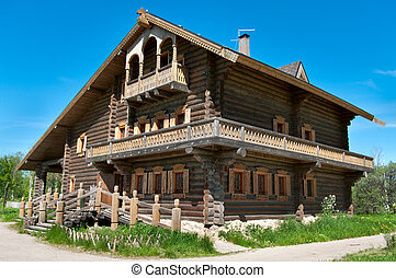 Wooden big house from timbers and windows on it It is in a...
