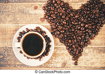 Big coffee bean heart - Huge coffee bean heart and coffee...