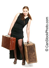 One beautiful woman in black dress and two ancient suitcases...