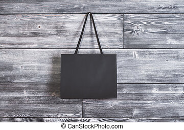 Shopping bag hanging on wall - Blank shopping bag hanging on...