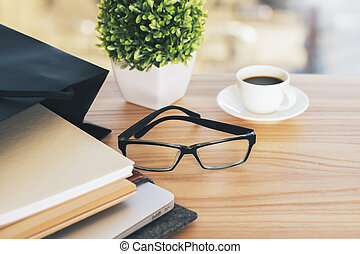 Desktop with glasses and plant - Wooden desktop with...