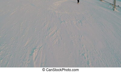 Group Of Young Skiers On Snowy Hill Slope - Aerial shot of a...