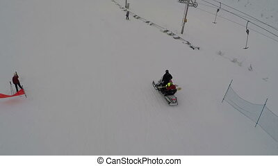 Chair Lift At A Ski Resort - Aerial shot of a of skiing and...