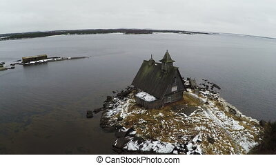 Aerial view of old house on winter coast - Aerial shot of...