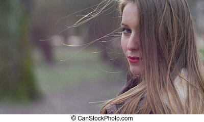 Young stylish hipster girl with red lips softly touching...