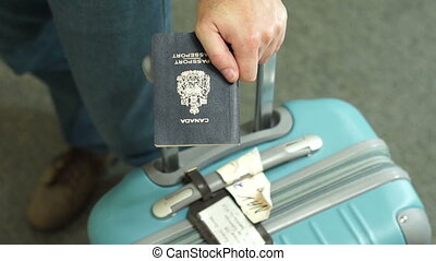 Canada Travel Passport Luggage Male - Anonymous male holding...