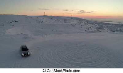 Car drifting on snow, aerial view - Aerial shot of skilled...
