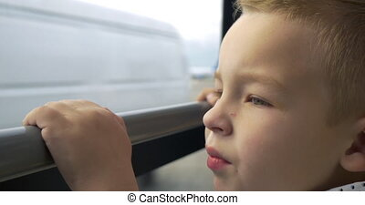 Child having a bus ride on airport area - Close-up shot of a...