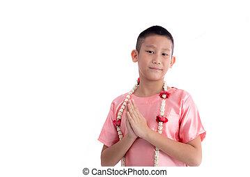 Asian boy welcome expression Sawasdee on white background