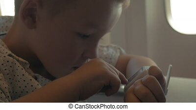 Little Boy in Smart Watch - Little boy is using smart watch...