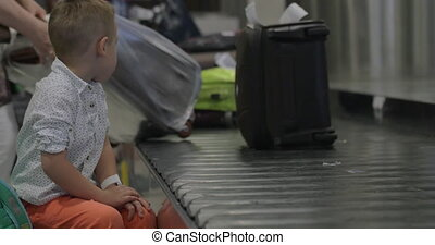 Little child at baggage claim area - Slow motion of a little...