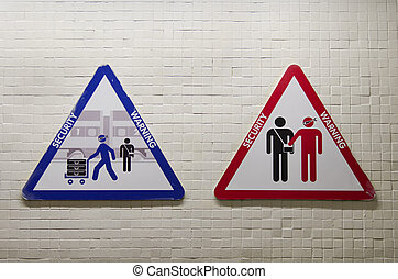 triangular sign to warn about the risk of being robbed by...