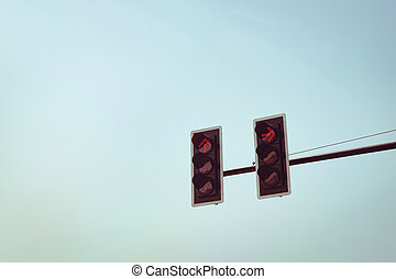 traffic light red with vintage sky background