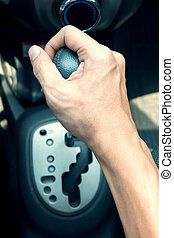 driver man hand holding automatic transmission in car