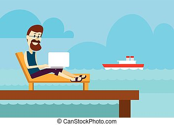Man On Sunbed Using Laptop Freelance Beach Remote Working...