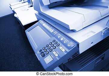 copier center or desktop in office showing paperwork concept