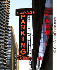 Neon Parking Garage Sign in an Urban Location