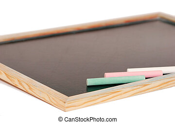 stick of color chalk on a blackboard isolated background -...