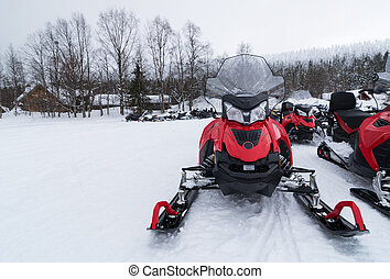 Snowmobiles - Group of snowmobiles ready for a ride in...