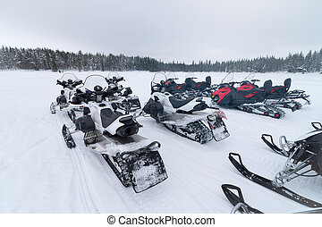 Group of snowmobiles ready to go